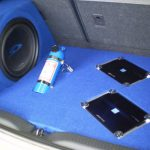 "Toyota Corolla Custom Boot Install - Custom boot installation, 2 Alpine PDX Amplifiers, 12"" Type-S Subwoofer. Blue felt finish."